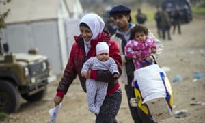 Refugees cross the border between Greece and Macedonia earlier this month.