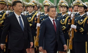 Xi Jinping, left, and Moon Jae-in attend a welcome ceremony at the Great Hall of the People in Beijing.