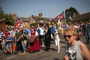 Teams from the English villages of Hallaton and Medbourne in Leicestershire walk to the start of the Easter Monday hare pie scrambling and bottle kicking event.