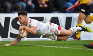 England's Oliver Gildart dives over the line to score the decisive try against New Zealand