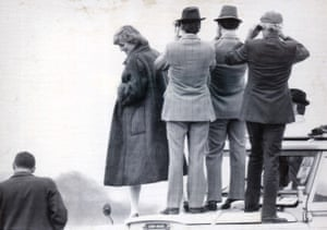 Diana, Princess of Wales, watches the Grand National from the bonnet of a Land Rover in 1982