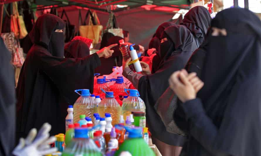 Women shop for disinfectant at a market in the Yemeni capital, Sana'a, amid concerns about the Covid-19 pandemic.