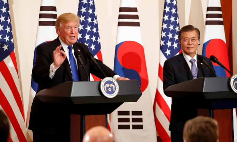 President Donald Trump talks to journalists alongside South Korea's president Moon Jae-in at a news conference in Seoul