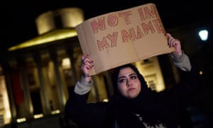 A woman holds a placard at a vigil in Trafalgar Square on Thursday.