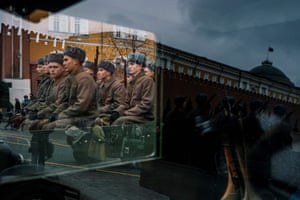 Soldiers are seen through a truck window as they take part in a military parade in Red Square as part of the ceremonies marking the 78th anniversary of the 1941 historical procession.
