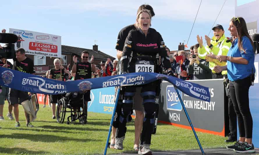 Claire Lomas crosses the finish line on Sunday.