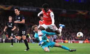 Arsenal's Bukayo Saka (right) is thwarted by Eintracht Frankfurt goalkeeper Frederik Rönnow.