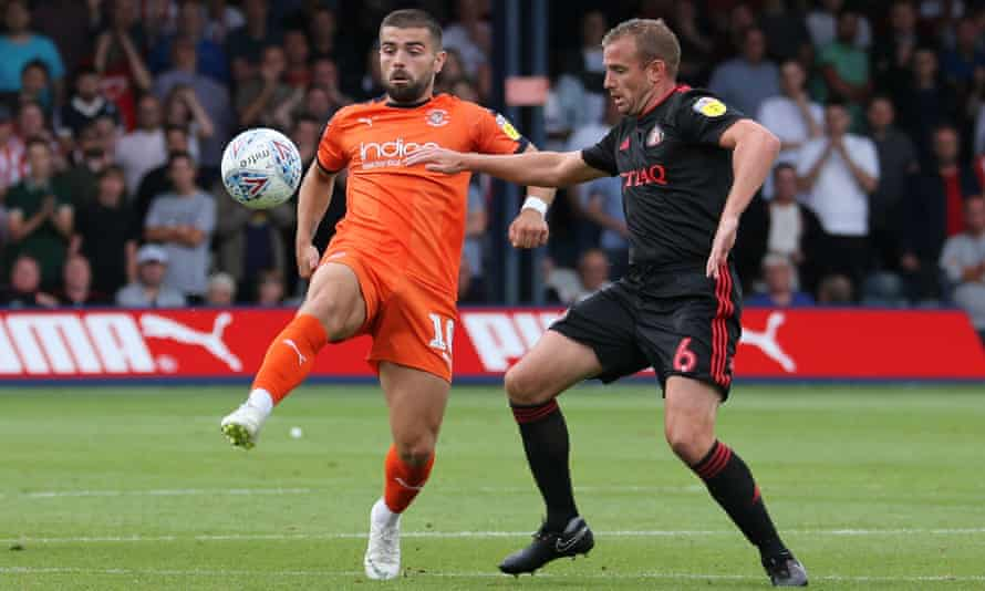Sunderland's Lee Cattermole (right) battles for the ball with Elliot Lee during last Saturday's 1-1 draw at Luton.