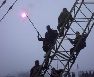 1996: Newbury bypass protesters climb on to a crane in the secure area, despite police efforts to stop them.