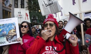 Members of the Chicago Teachers Union and SEIU Local 73 march on 14 October 2019.
