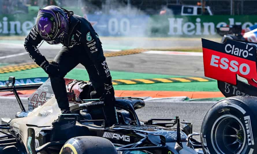 Lewis Hamilton climbs out of his car after the collision with Max Verstappen during the Italian Grand Prix.
