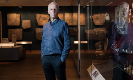 Prof Chris Gosden of Oxford University with artefacts in the background