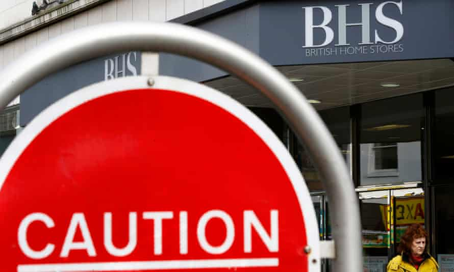 A woman walks past a BHS store in Leicester.