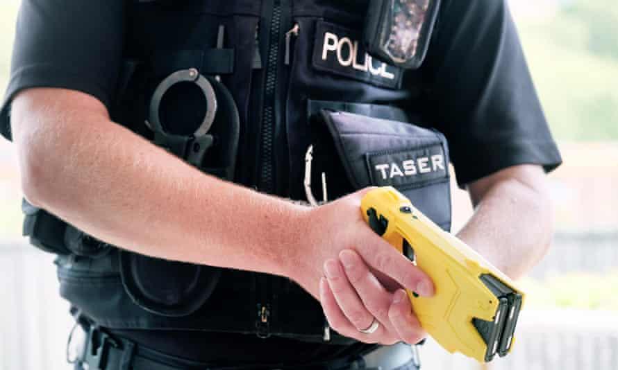 Police officer with Taser