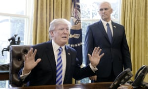 Donald Trump with his hands in the air, Mike Pence in the background