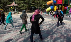Iranian women exercise together in a central Tehran park.