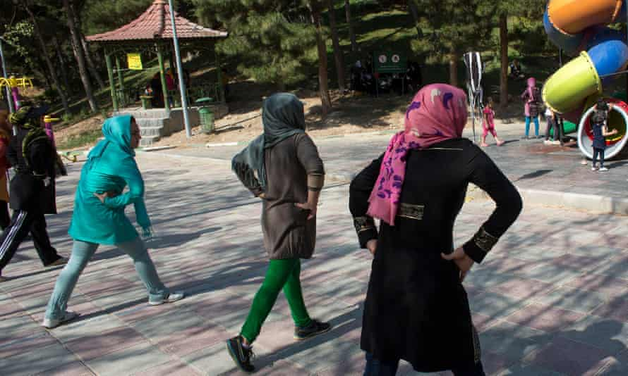 Women exercise in a park in Tehran