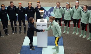Eleanor Shearer, president of Oxford University Women's Boat Club shakes hands with Abigail Parker, president of Cambridge University Women's Boat Club.