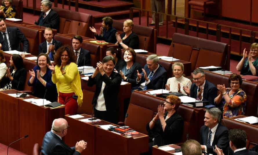 Senators celebrating the result of a vote passing the marriage eqaulity bill in the Senate at parliament house on 29 November 2017 in Canberra, Australia.