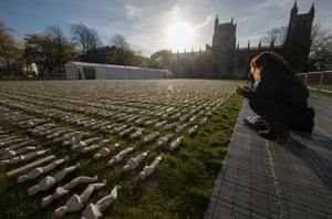 Bristol, UK The early morning autumn sun illuminates some of the 19,240 figurines that have been laid out on College Green as part of the 19240 Shrouds of the Somme art installation. A memorial service will be held today beside the artwork by Rob Heard