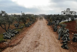 Qaminas, SyriaTurkish soldiers gather in the village of Qaminas. Turkey sent additional troops into the region and threatened to respond if its military observation posts in Idlib, set up under a 2018 truce, came under attack.