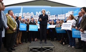 Theresa May addresses supporters in front of the party's election campaign bus at an airfield north of Newcastle, north-east England.