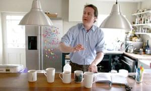 David Cameron prepares hot drinks in his kitchen