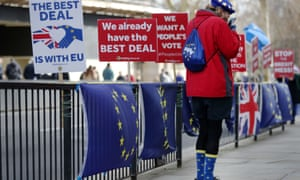 A remain supporter sports European flag socks while standing across the street from the Palace of Westminster.