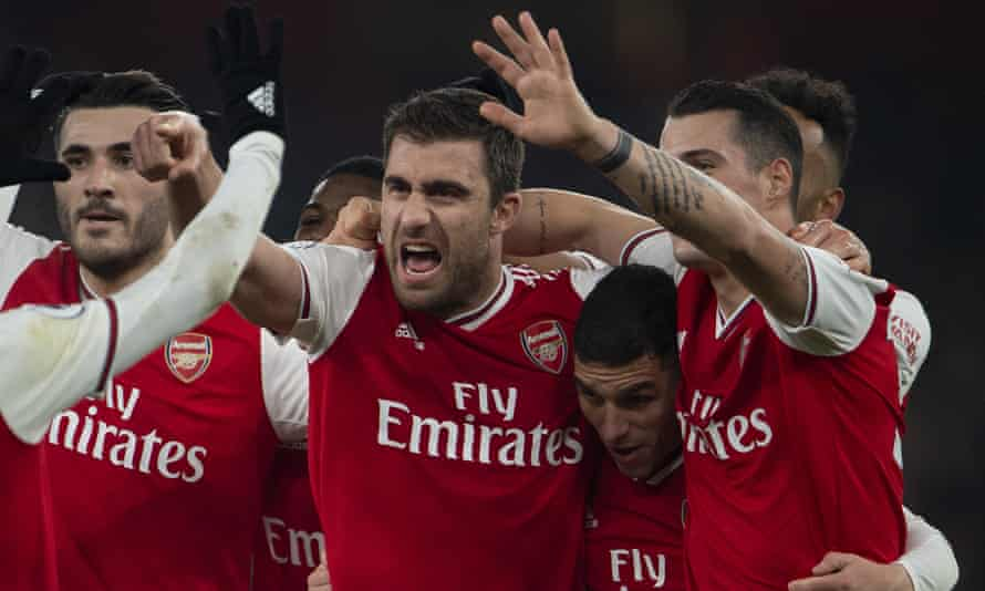 Sokratis Papastathopoulos, centre, celebrates his goal against Manchester United on Wednesday.