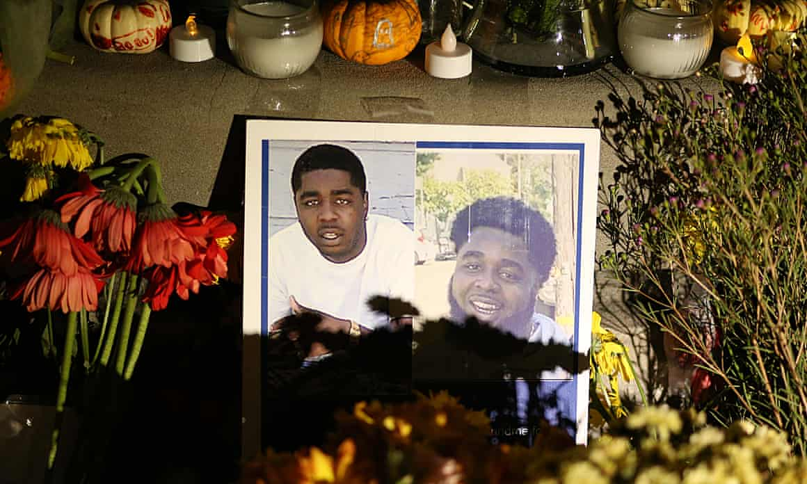 A composite photo of Raymon Hill Jr. is displayed in a makeshift memorial after his death at an Airbnb house rental shooting in Orinda, Calif., on Tuesday, Nov. 5, 2019.