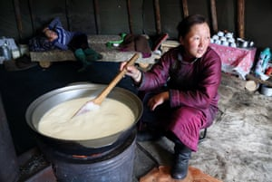 Bolorma boils the daily milk ration the family needs to feed themselves