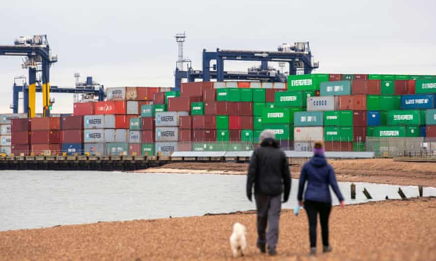 Shipping containers are unloaded at Felixstowe in Suffolk.
