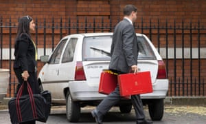 Official government briefcases being taken away from Carlton Garden, which was Boris Johnson's government home until he resigned as foreign secretary.