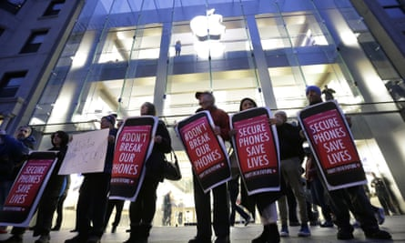 Protesters carry placards outside an Apple store in Boston in February.