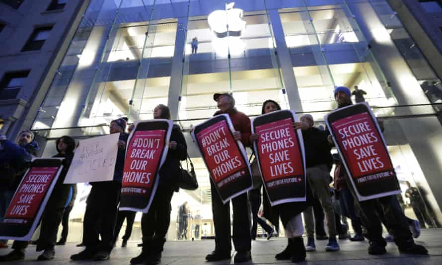 Protesters carry placards outside an Apple store in Boston, 2016. Cook reiterated his commitment to user security in his interview with Fortune.