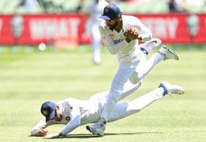 Ravindra Jadeja of India takes a catch ahead of teammate Shubman Gill of India to dismiss Matthew Wade at The MCG.