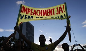 An anti-government protester carries a sign saying 'Impeachment now!' outside the presidential palace in Brasilia.