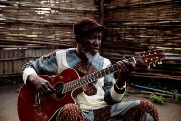 Emmanuel Kembe playing guitar