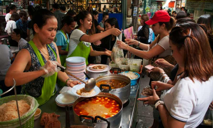 'It brings all the classes together': office workers buy khanom chin, spicy curry and fresh noodles.