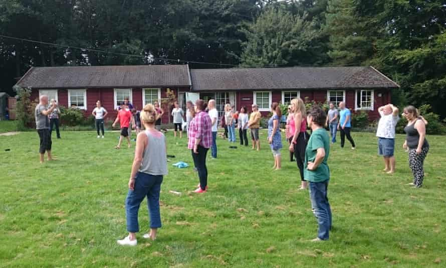 Guests, stand outside, during a Mindfulness Retreat, Suffolk.