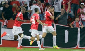 Hapoel Beer Sheva's Shir Tzedek, right, celebrates after scoring the only goal of the Champions League third round qualifying tie against the Greek side Olympiakos, giving the Israeli champions a place in the play-off round and a meeting with Celtic.