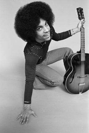 'This is at my studio at the Kemp Ice Cream building. It was our second day of shooting, music was playing and we had enough ice cream for all of us. Prince said: I want to shoot with my guitar. I thought grey was the perfect background. I was trying my wide angle lens and that moment he gave me a big smile. At that moment it was quite normal but now it is unique – you won't see Prince smiling so much in other photos'