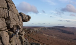A rock climber in the December sun at Stanage Edge, Derbyshire, 2015.