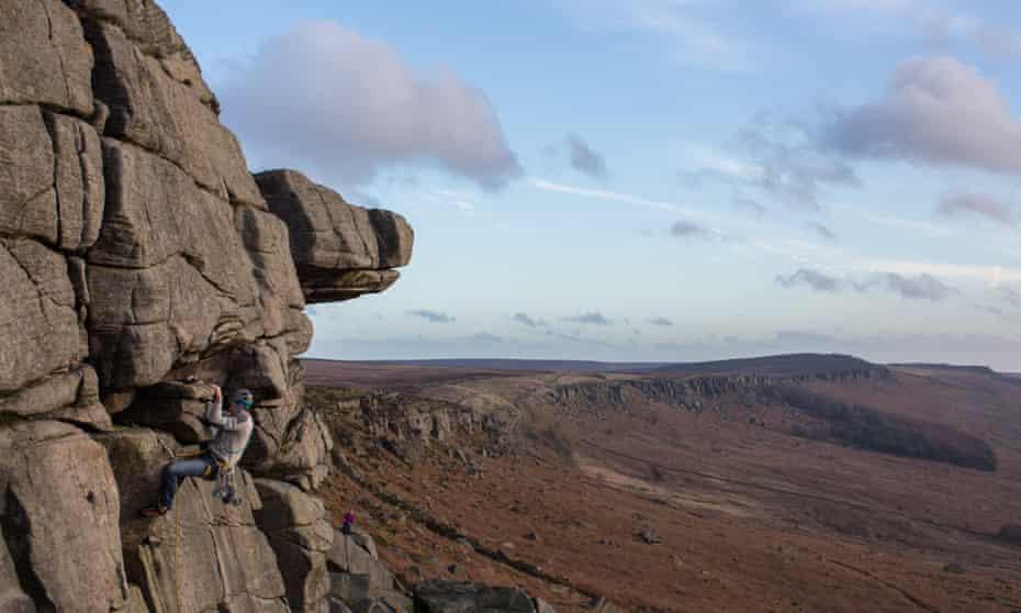 A rock climber at Stanage Edge, Derbyshire.