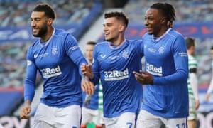 Connor Goldson, Ianis Hagi and Joe Aribo of Rangers celebrate after Callum McGregor's own goal.