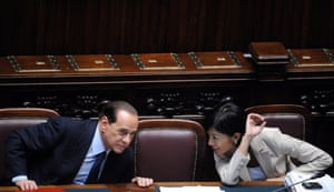 """May 2008: Berlusconi speaks to the equal opportunities minister Mara Carfagna, a former topless model and showgirl, after a parliamentary no-confidence vote. Berlusconi said about Carfagna: """"If I was not already married I would have married her immediately."""" The comment caused Berlusconi's then wife, Veronica Lario, to demand an apology through a national newspaper"""