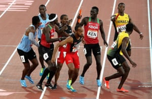 Athletes get in a tangle at the baton exchange in the men's 4x400m relay final