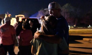 Lexa Roberts and Cody Shaw of Spring, Texas embrace after the vigil.