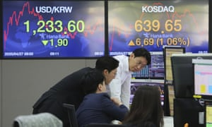 Currency traders at the foreign exchange dealing room of the KEB Hana Bank in Seoul, South Korea, today