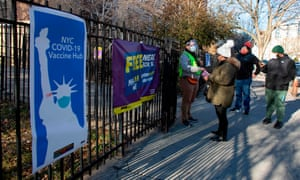 People arrive to receive a dose of the Moderna coronavirus vaccine at the vaccination site at the South Bronx Education Campus in the Bronx, New York on January 10, 2020.